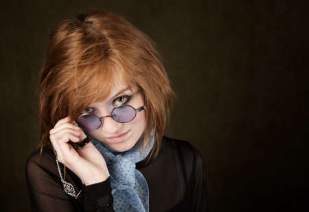 Pretty teenage girl with round blue sunglasses