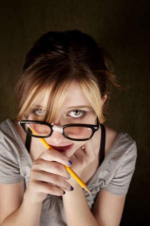 dweeb: Portrait of nerdy teen girl with green eyes Stock Photo