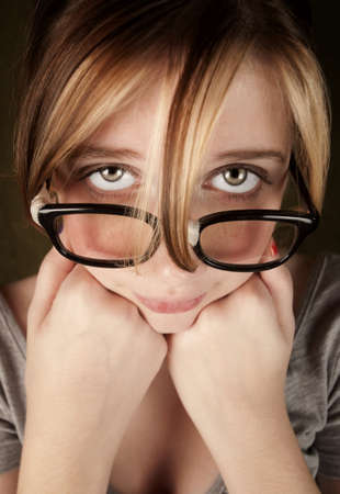 dweeb: Portrait of nerdy teen girl with green eyes Stock Photo