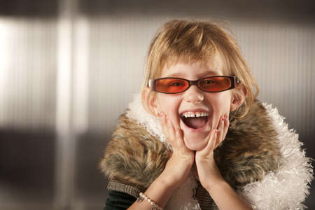 dressup: Cute young girl in dress-up clothes and red sunglasses Stock Photo