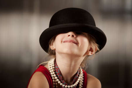 Funny young girl with her face hidden in her hat Zdjęcie Seryjne - 4510743
