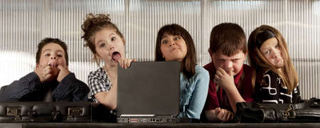 unprofessional: Kids posing as a professional business team making funny faces