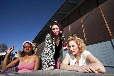 Portrait of three trashy women outdoors photo