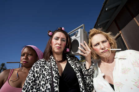 Portrait of three trashy women outdoors photo