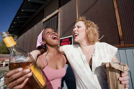Portrait of two trashy drunk women outdoors photo