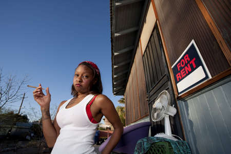 African-American woman in front of rental house Stock fotó