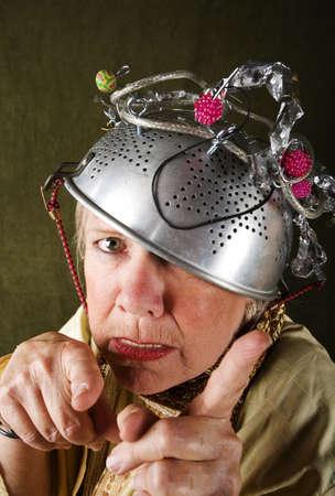 crazy woman: Crazy woman wearing a metal colander for a helmet