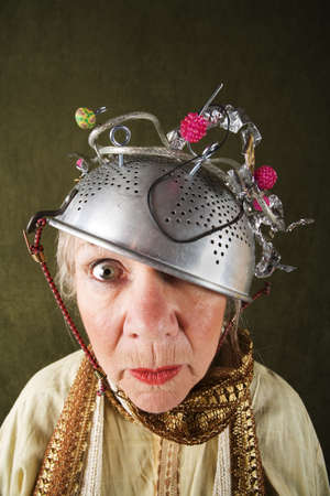 a colander: Crazy woman wearing a metal colander for a helmet
