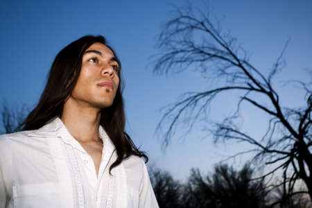and the horizontal man: Handsome young man with long hair in an outdoor setting Stock Photo