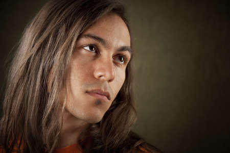 native american man: Closeup Portrait of a Handsome Young Man with Long Hair
