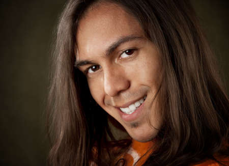 Closeup Portrait of a Handsome Young Man with Long Hair photo