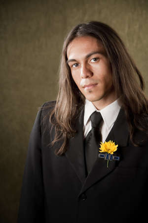 boutonniere: Handsome man in formal jacket with boutonniere