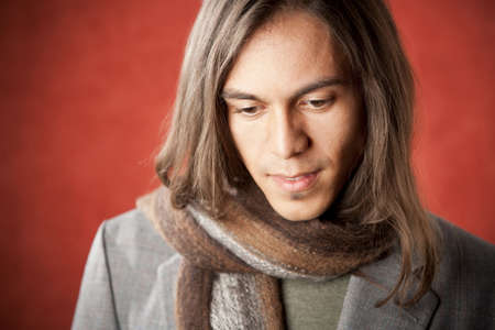 Closeup Portrait of a Handsome Young Man with Long Hair