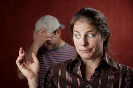 spat: Guilty woman with upset man in the background