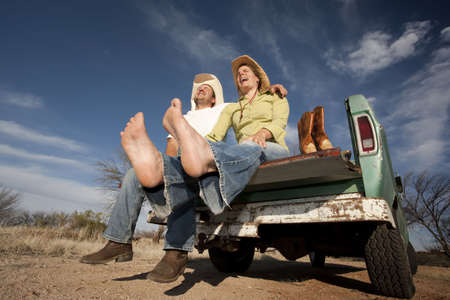 cowboy beard: Portrait of Cowboy and woman on pickup truck bed