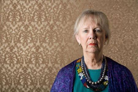 eccentric: Closeup Portrait of an Eccentric Senior Lady Stock Photo