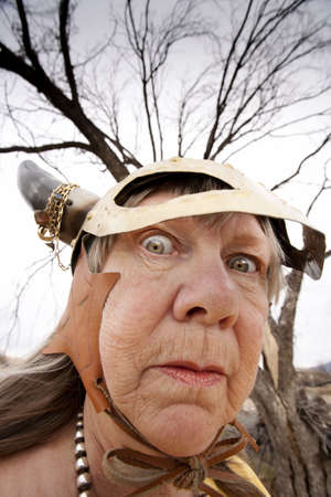 elder tree: Crazy old woman wearing a Viking helmet Stock Photo