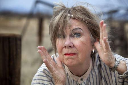 Crazy old woman outdoors with wild makeup Stock fotó