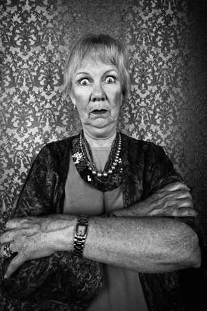 Portrait of an Eccentric Senior Lady with Wild Eyes Banco de Imagens