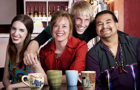 Four friends posing in a coffee house photo