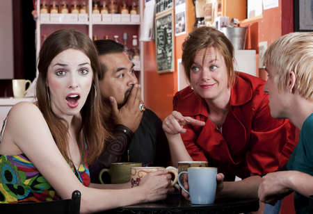 Four friends having an animated discussion in a coffee house photo