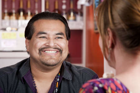 native american man: Handsome Native American man with female friend in a restaurant Stock Photo