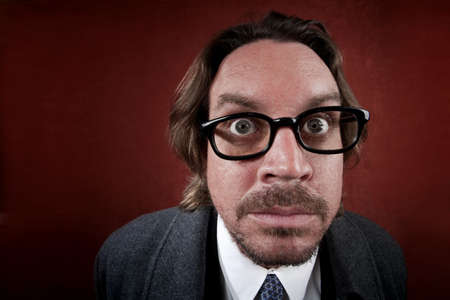 Potrait of worried rugged man with glasses making a funny face Stock Photo - 5176665