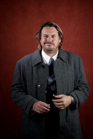 Aggressive businessman with big cocky smile Stock Photo - 5176652