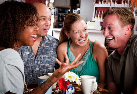 Four adult friends meeting in a coffee house photo