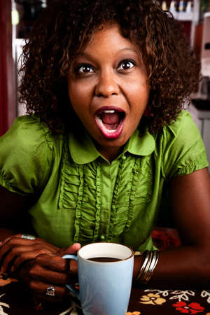 gasp: Pretty African American woman with shocked expression on her face