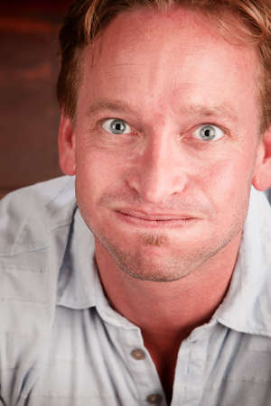 exasperation: Handsome blonde man with funny expression shot from above Stock Photo
