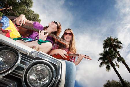 gutar: Female Musicians on an Old Car