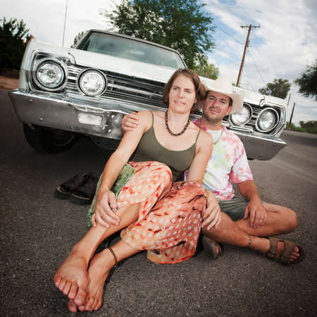 beard woman: Happy Adult Couple with Vintage White Car