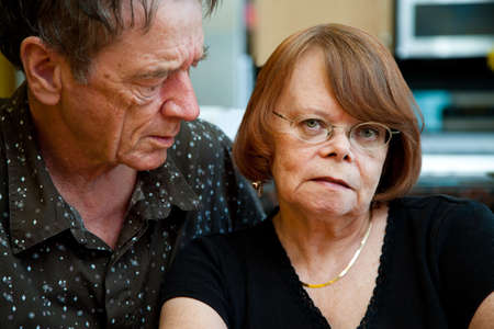 senile: Worried Senior Couple at Home in Modern  Kitchen