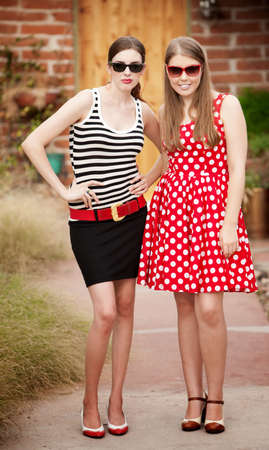 Fashion Girls on Walkway in front of House photo