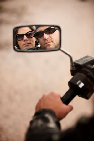 mirror: Reflection of Motorcycle Driver and Rider in Rearview Mirror