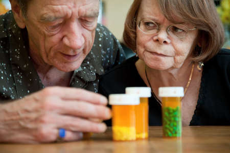 Senior couple closely examining instructions on prescription medications photo