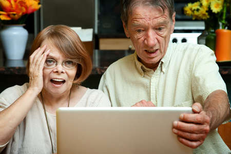 revulsion: Senior couple shocked at the content on their laptop computer