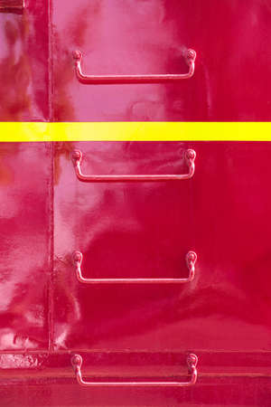 rungs: Metal ladder rungs on the side of red train caboose