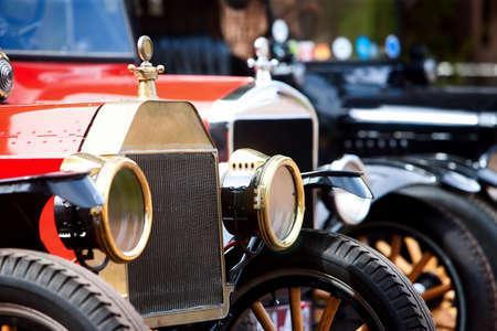 auto focus: Headlights on several lined up vintage cars