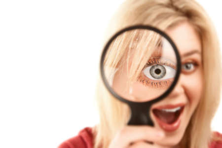 Pretty Young Blonde Woman Looking Through Magnifying Glass photo