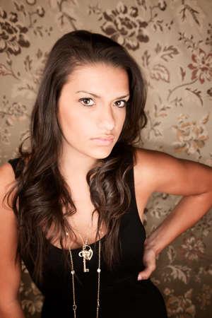 Portrait of beautiful brunette Hispanic woman in black dress photo