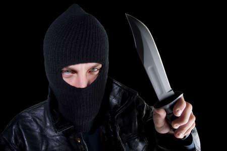 delinquent: Young man in black with large knife