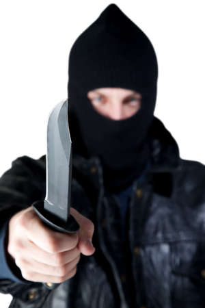 brandishing: Young male criminal brandishing knife with large blade
