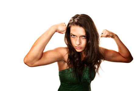 Beautiful Latina woman with dark eyes and brunette hair flexing her muscles Stock Photo - 5827636