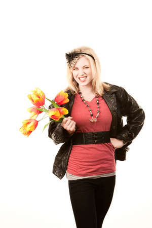 fake smile: Pretty toung blonde woman with colorful plastic tulips