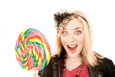 Pretty young blonde woman with large colorful lollipop photo