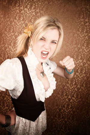 Pretty young blonde girl throwing a punch photo