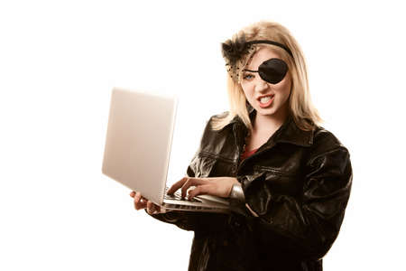 Internet pirate committing online fraud or identity theft photo