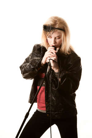 comedian: Pretty young female blonde singer or comedian with microphone Stock Photo